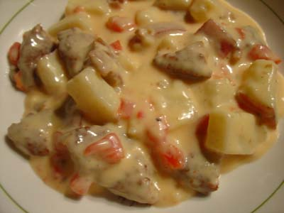 Potatoes and Veggie Sausage con Queso