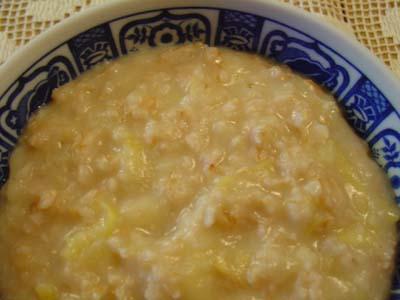 Bowl of oatmeal and apple