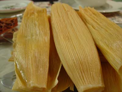 Plate stacked with tamales